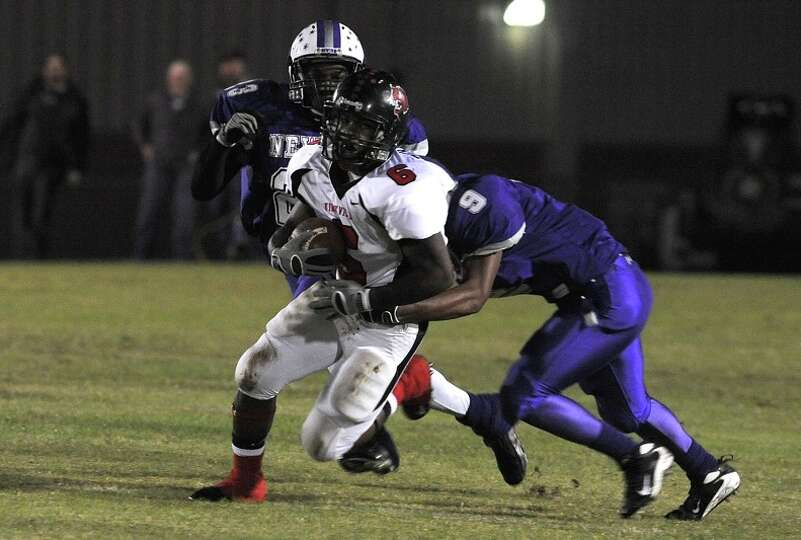 Kirbyville's Barry Burley is taken down by Newton's defense during a match up at the Eagle's stadium
