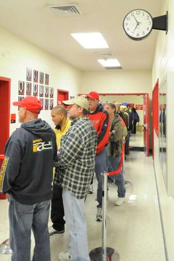 Lamar Football  fans wait for the clock to strike at 7 a.m. on Saturday morning to purchase season t