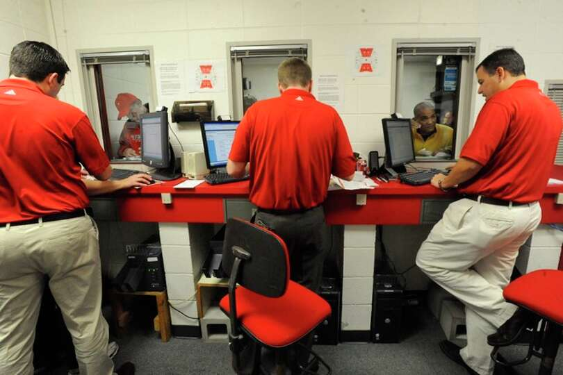 Lamar Athletics officials help the first set of customers choose seats for Lamar Football season tic