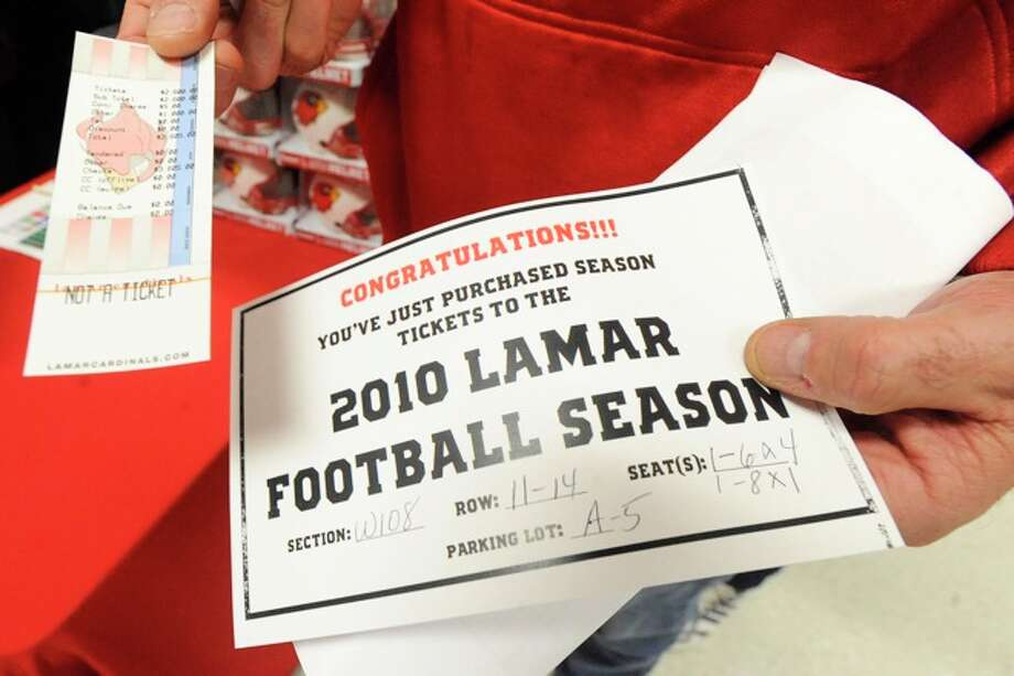 Larry Reece holds the receipt for his just purchased 2010 Lamar Football season tickets. Lamar University began selling season tickets at 7 a.m. on Saturday, with some Lamar fans lining up overnight to be the first in line for good seats. Photo: VALENTINO MAURICIO