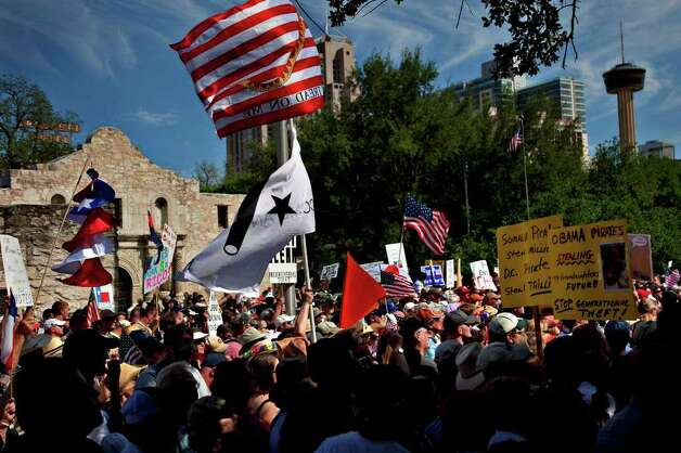 A large crowd gathers on Alamo Plaza for a Tea Party Wednesday, April 15, 2009.  There were protests nationwide to rally against excessive government spending. NICOLE FRUGE/nfruge@express-news.net Photo: NICOLE FRUGE, SAN ANTONIO EXPRESS-NEWS / nfruge@express-news.net