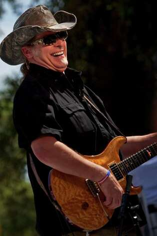 Ted Nugent performs at  Alamo Plaza for a Tea Party Wednesday, April 15, 2009.  There were protests nationwide to rally against excessive government spending. NICOLE FRUGE/nfruge@express-news.net Photo: NICOLE FRUGE, SAN ANTONIO EXPRESS-NEWS / nfruge@express-news.net