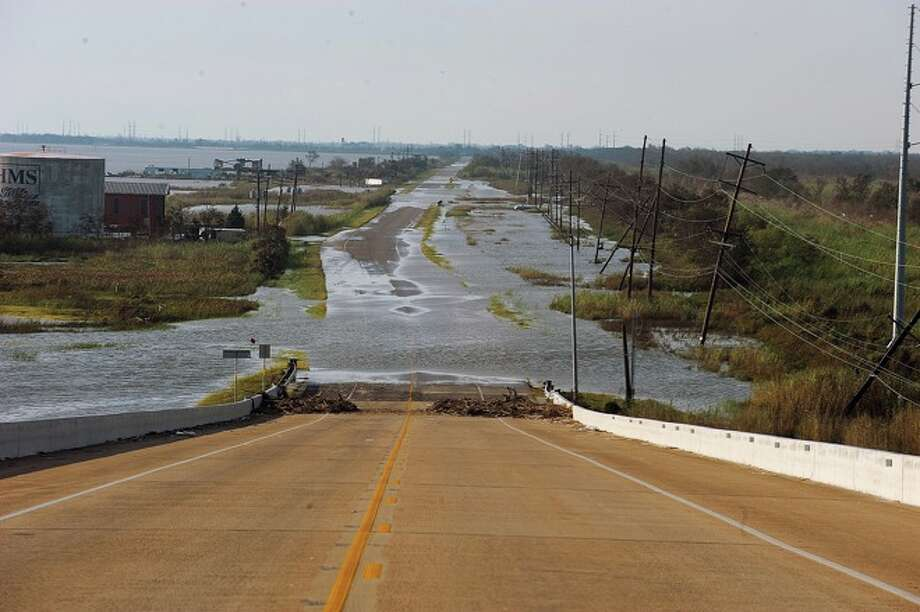 Roads are flooded on Texas 87 leaving access to Sabine Pass impossible. Monday, September 15, 2008 Guiseppe Barranco/ Photo: THE ENTERPRISE