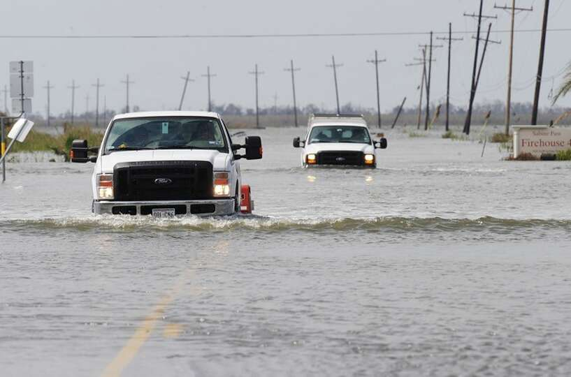 Waters on Texas 87 to Sabine Pass are slowly receding. Guiseppe Barranco/