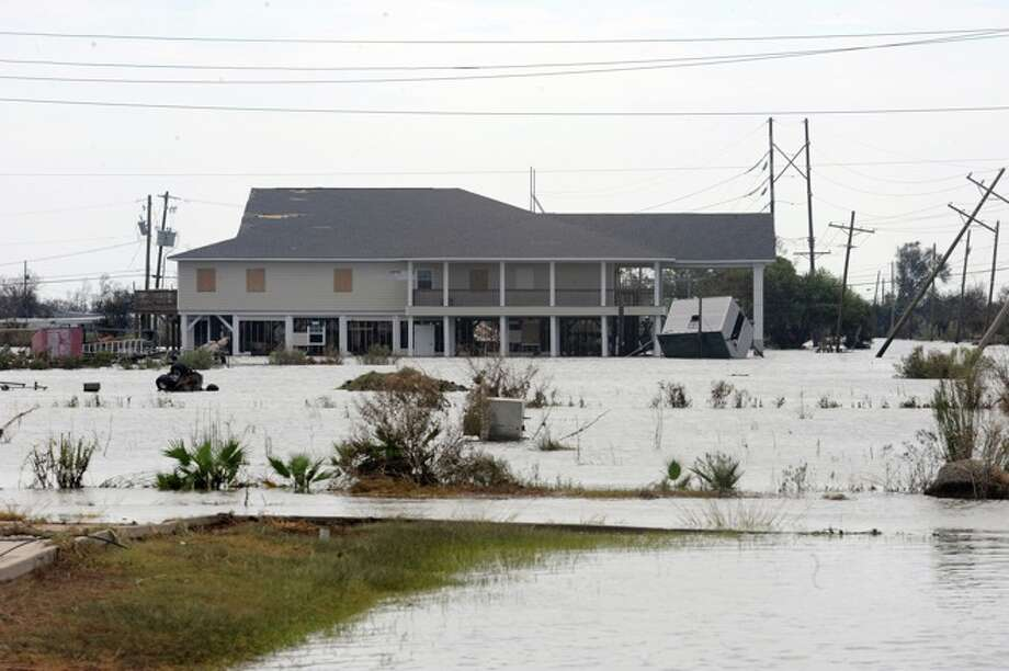 Several Sabine Pass homes that were rebuilt from Rita on piers with stood the winds of Hurricane Ike. Guiseppe Barranco/ Photo: THE ENTERPRISE