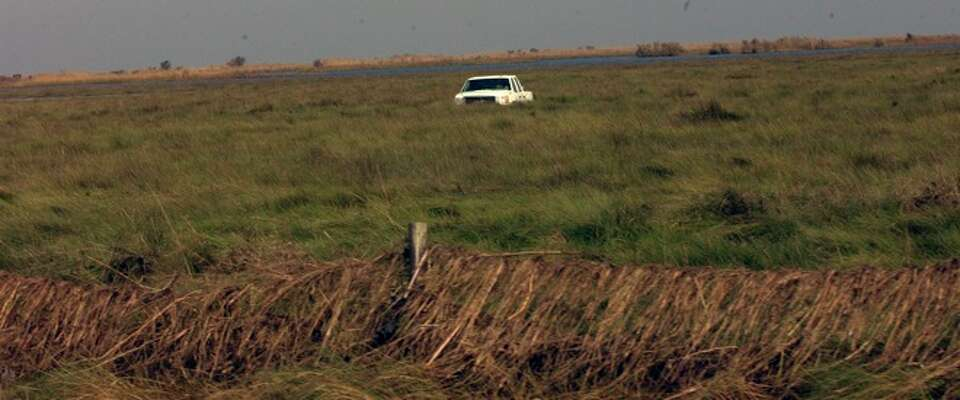 A lone truck sits in the marsh just outside Sabine Pass after being moved by Hurricane Ike's winds a