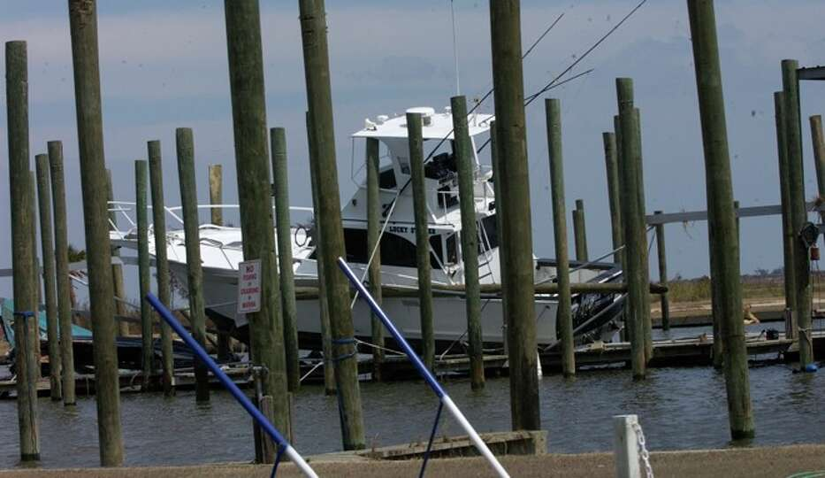 The Sabine Pass Yacht Club Marina still had two damaged boats left in it after the passage of Hurric