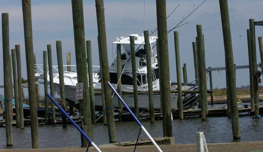 The Sabine Pass Yacht Club Marina still had two damaged boats left in it after the passage of Hurricane Ike.  Dave Ryan/ Photo: THE ENTERPRISE