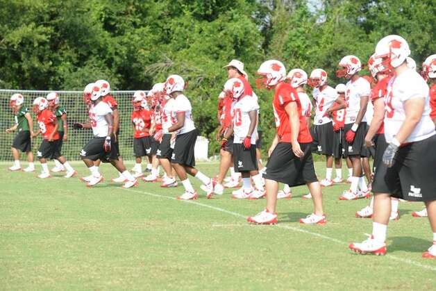 Lamar football players take the practice field as Lamar University conducts it first football practice since the 1989 season. The team held walk-on tryouts along with a practice for scholarship players. The Cardinals will continue to practice through the fall. Wednesday, August 26, 2009. Photo: VALENTINO MAURICIO