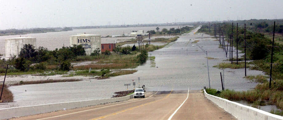 A view from the top of the Intercoastal Canal Bridge on highway 87 to Sabine Pass shows water over the road as Hurricane Ike gets closer to the coast.  Dave Ryan/ Photo: THE ENTERPRISE