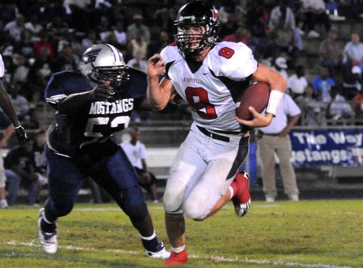 Kirbyville's Caleb Cucancic tries to gain yardage as WO-S's Lawrence Gilmore goes in for the tackle