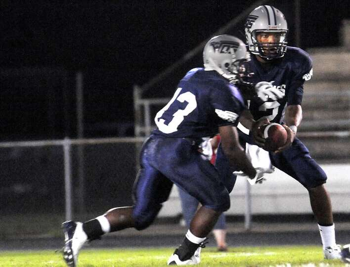 WO-S's Reggie Garrett fakes a hand off to DeCarlos Renfro during the game against Kirbyville at West