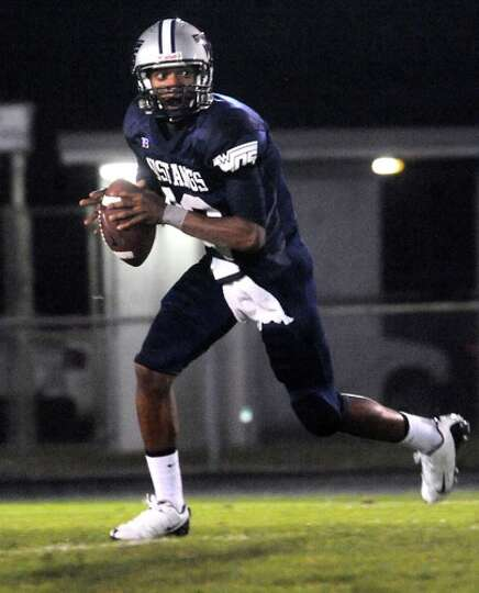 WO-S's Reggie Garrett looks to pass against Kirbyville at West Orange Stark High School in West Oran