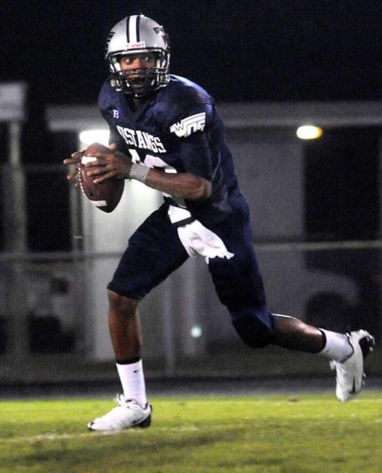 WO-S's Reggie Garrett looks to pass against Kirbyville at West Orange Stark High School in West Orange, Friday. Photo: TAMMY MCKINLEY