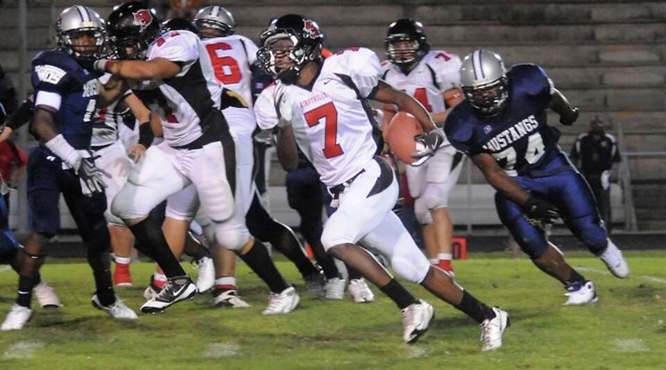 Kirbyville's Fred Rhodes runs for yardage against WO-S at West Orange Stark High School in West Oran