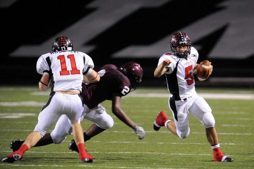 Kirbyville quarterback, Aaron Hazelwood dashes out of bounds for a short gain in the second quarter