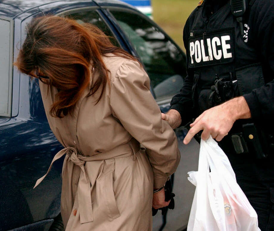 A woman is processed by the Beaumont Police Department after being arrested in a sting operation for prostitution in Beaumont on Wednesday, Jan. 3, 2006. The police department cracked down on prostitution and solicitation throughout the city. Mark M. Hancock/ Photo: THE ENTERPRISE