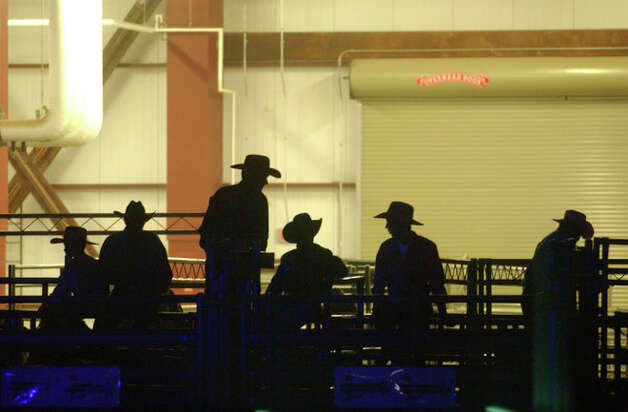 Bull riders and participants of the 2007 PBR Beaumont Invitational wait as they are introduced to the crowd Friday, Jan. 12, 2007, at Ford Arena in Beaumont. Andrew Nenque/ Photo: THE ENTERPRISE