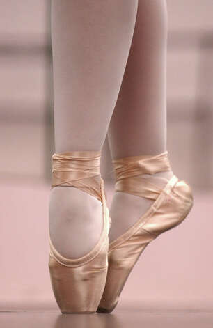 Emily Larkard, 21, of China goes on pointe before practice for 'Cinderella' at Bonnie Cokinos School of Dance in Beaumont on Wednesday, Feb. 21, 2007. Mark M. Hancock/ Photo: THE ENTERPRISE