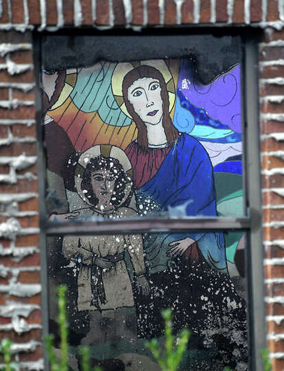 A mural at the Our Lady of Victory Catholic Church's CCD building is damaged by fire that was starte