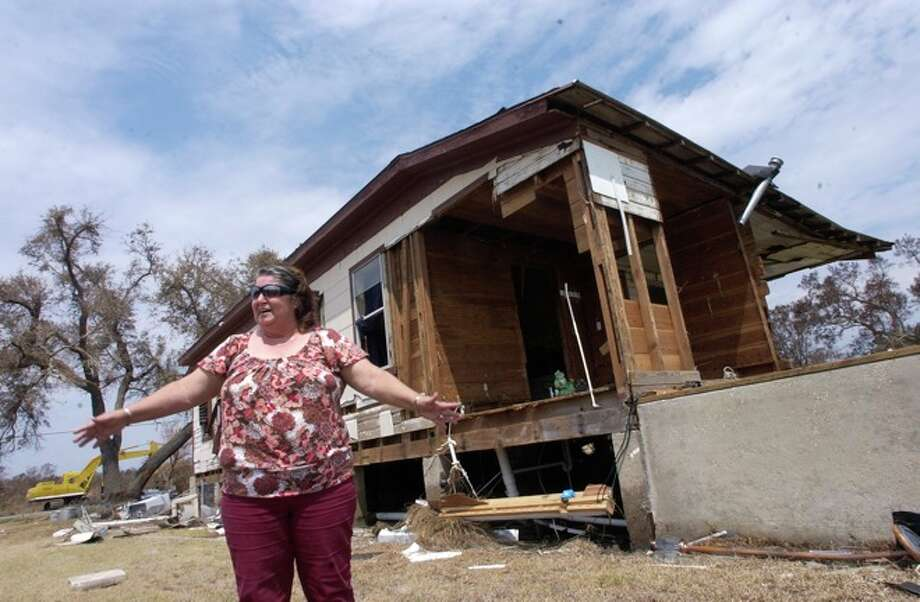 Diane Bergeron, a Sabine Pass resident, says they will stay and rebuild their home.  Dave Ryan/ Photo: THE ENTERPRISE