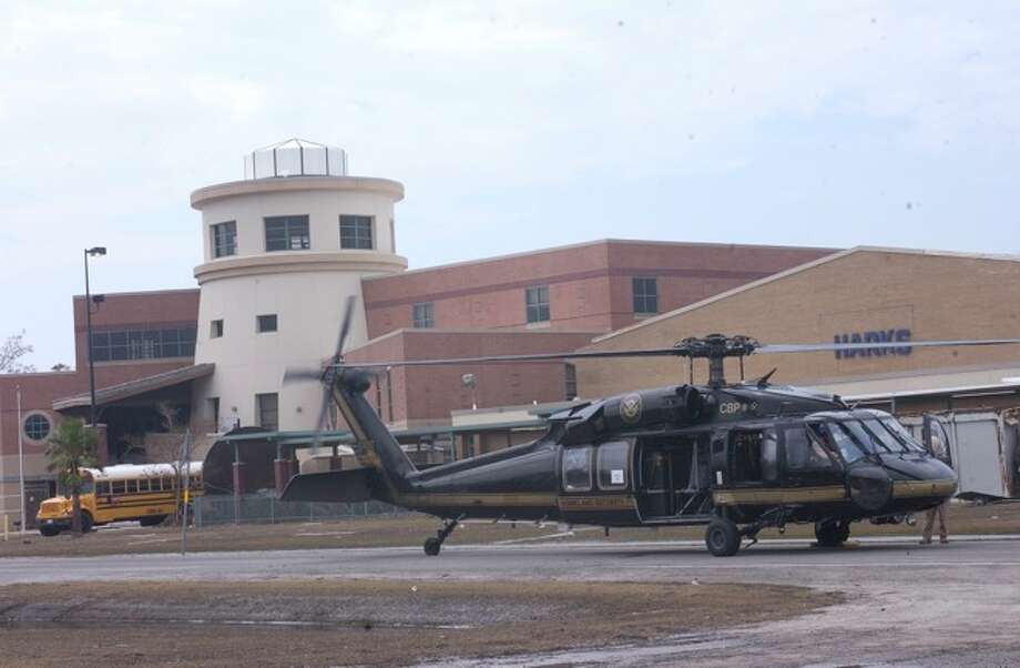 Sabine Pass ISD Sabine Pass High SchoolGraduation: 7:30 p.m. June 6 in the Frankie Schexnayder Auditorium (File photo) A helicopter carrying the U.S. Department of Homeland Security Chief Michael Chertoff, sits in front of Sabine Pass High School.  Dave Ryan Photo: THE ENTERPRISE