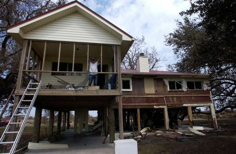Neil Morgan, a Sabine Pass resident, looks over his property from his damaged home in Sabine Pass.