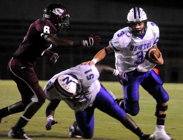 Newton't Halson Flanigan runs the ball as Tevin Adams tries to block Silsbee's Leroy Simmons at Sils