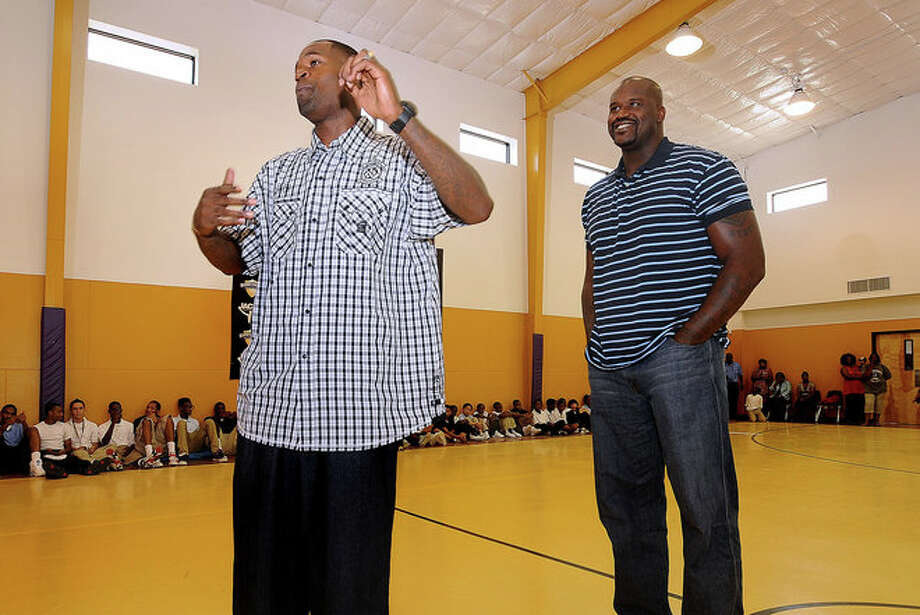 Stephen Jackson introduces Shaquille O'Neal to area youth at the Stephen Jackson Academy on Thursday. During the event, more than 6,000 pounds of food were distributed to families waiting in line since 4 a.m. Photo: Guiseppe Barranco