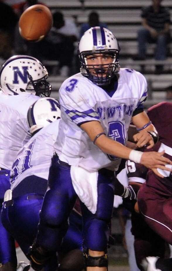 Newton's Halson Flanigan passes the ball agaisnt Silsbee at Silsbee High School in Silsbee, Friday. Photo: TAMMY MCKINLEY