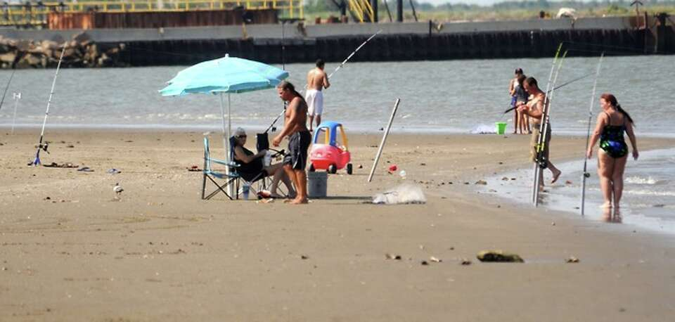Local residents spend the day at the beach on Sabine Pass, Sunday.