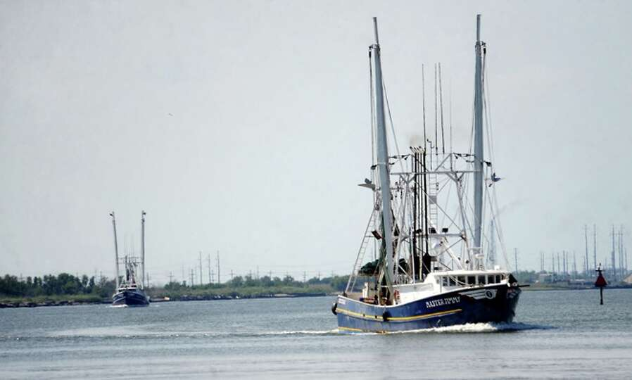 Shimp boats sail through the Intercoastal Waterway near Sabine Pass, Sunday.