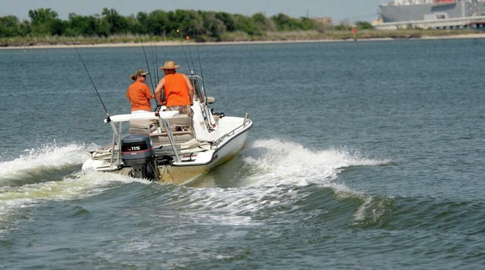 Boaters head out for some recreational fishing at Sabine Pass, Sunday.