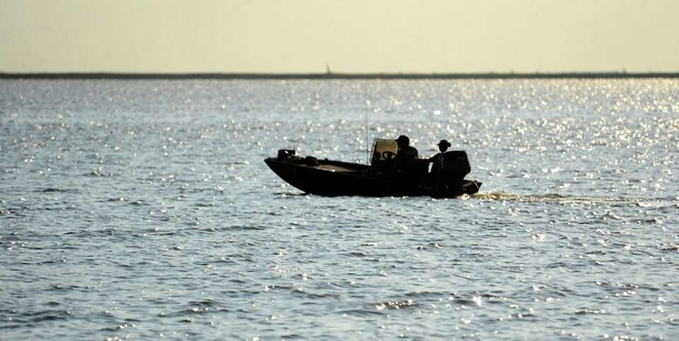 Recreational boaters enjoy the waters on Keith Lake near Sabine Pass, Sunday.