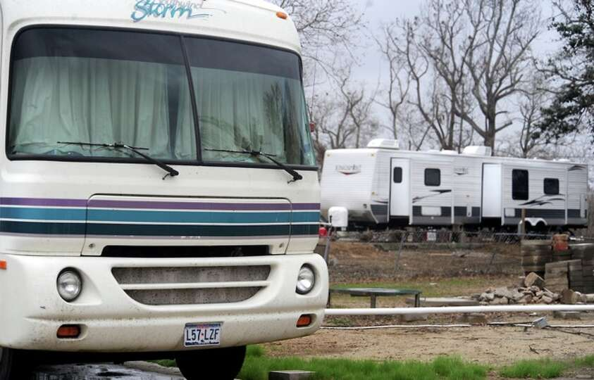 RV's and campers sit in driveways where homes once stood in Sabine Pass, Friday.