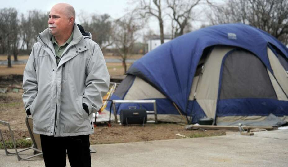 Adam Saunders talks about spending the holidays living in an RV trailer in Sabine Pass, Friday. Hurr