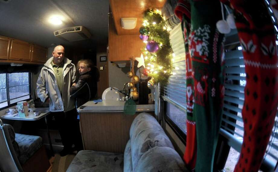 Adam Saunders and Olivia Saunders hang out in the RV they are living in after Hurricane Ikewiped out the family home Sabine Pass, Friday. Photo: TAMMY McKINLEY