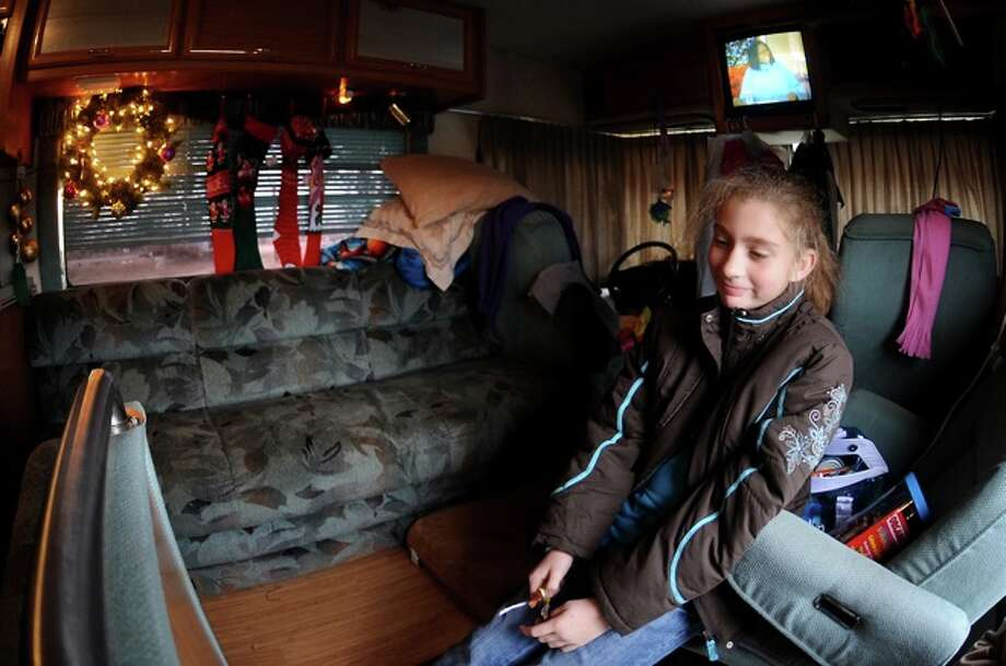Olivia Saunders hangs out in her father's RV in Sabine Pass, Friday. Hurricane Ike wiped out the Saunders' home. Photo: TAMMY McKINLEY