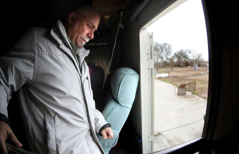 Adam Saunders exits the RV he is living in in Sabine Pass, Friday. Hurricane Ike wiped out Saunders' home. Photo: TAMMY McKINLEY