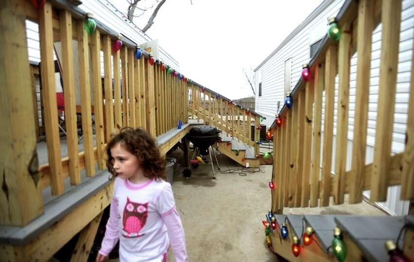 Chrislyn LaFauci walks between two FEMA trailers in Sabine Pass, Friday.