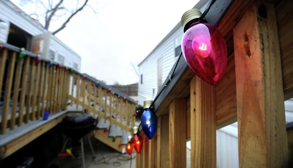 Christmas lights decorate the front entrances of a couple of FEMA trailers in Sabine Pass, Friday.