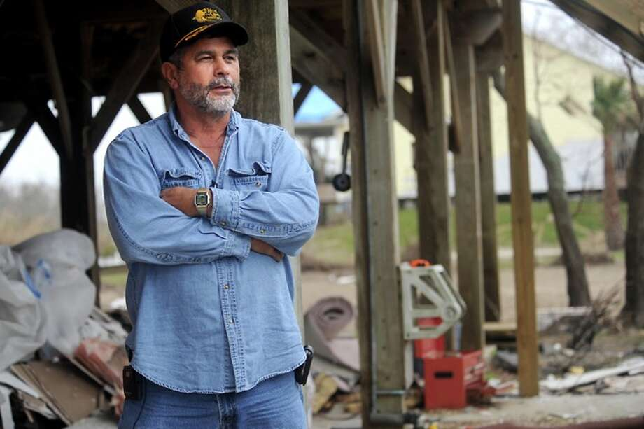 Bob Sexton talks about spending the holidays in a camper as he restores his home after Hurricane Ike damaged it in Sabine Pass, Friday. Photo: TAMMY McKINLEY