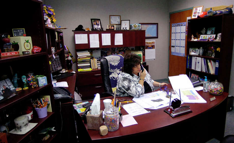 Kristi Heid, Principal of the Sabine Pass School, played a big role in the recovery efforts that went on in Sabine Pass after Hurricane Ike. Her office is full of mementos of her time as Principal.     Dave Ryan/The Enterprise Photo: EMILY GUEVARA