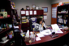 Kristi Heid, Principal of the Sabine Pass School, played a big role in the recovery efforts that went on in Sabine Pass after Hurricane Ike. Her office is full of mementos of her time as Principal.     Dave Ryan/The Enterprise