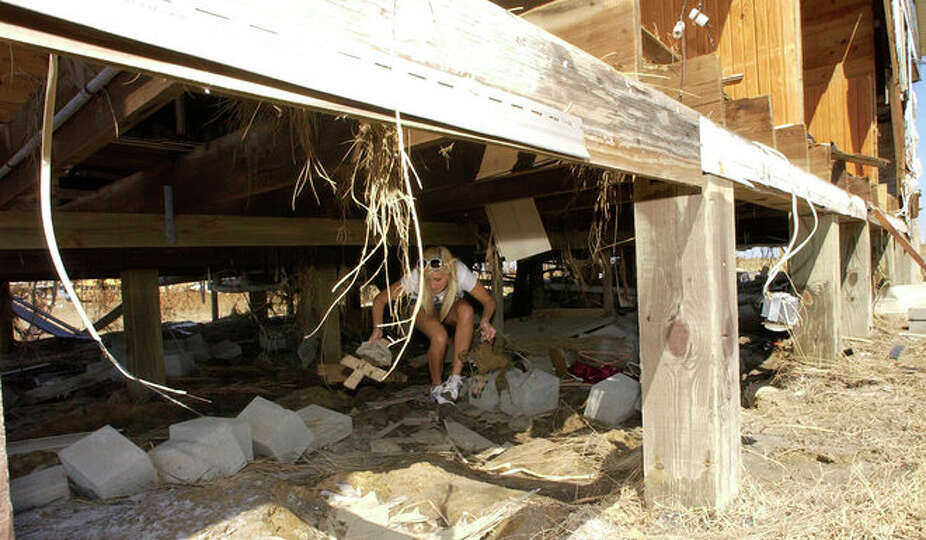 Sabine Pass High School Senior Rachael Olson finds a family cross under her house while doing a sear