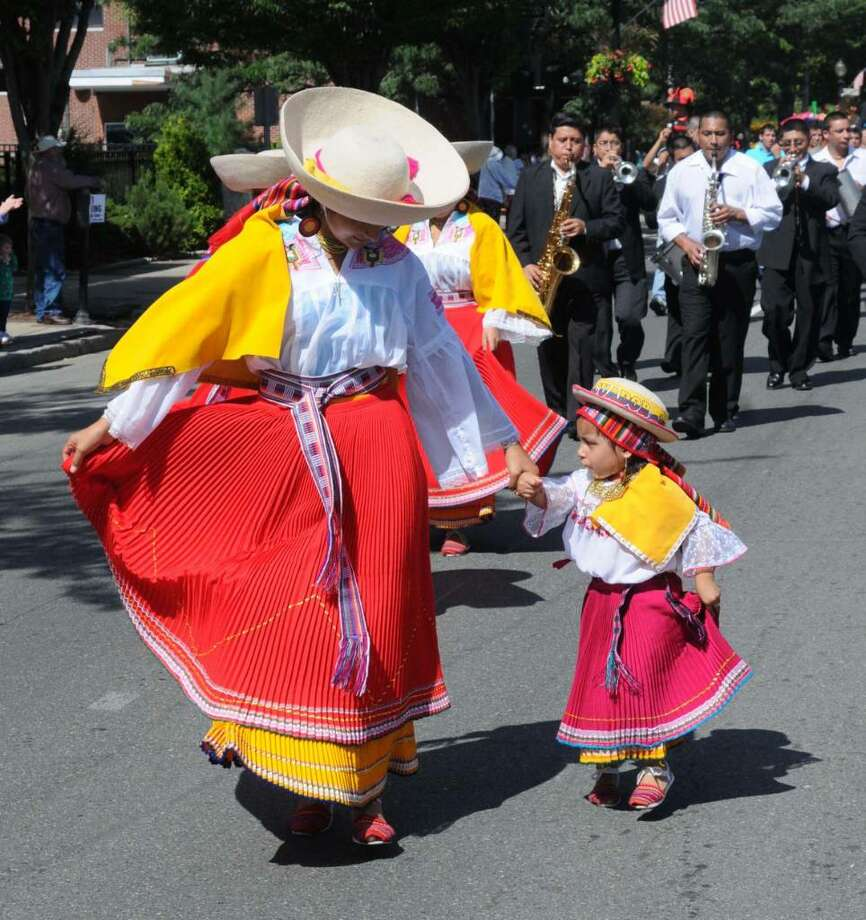The Danbury Newtimes Parade was held on Sunday Sept. 13, 2009. Jessica Ramos, 18, on left and Lita Tuba, 2, both of New Haven dance in the parade to traditional Ecuadorian music. Photo: Lisa Weir / The News-Times