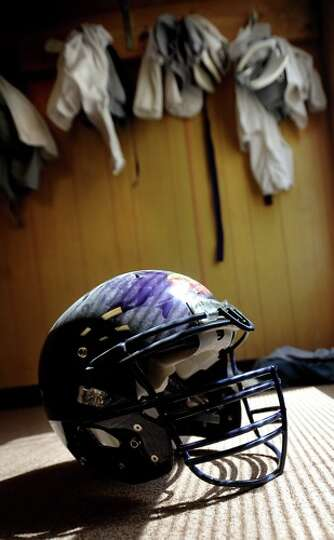 A helmut sits on the floor in the temporary lockerroom during the first day of two a day practices a