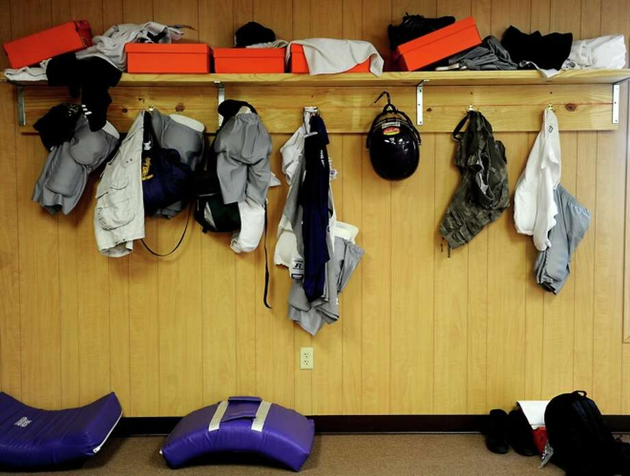 Clothing and gear are left out in the open during the first day of two a day football practice in the temporary locker room for Sabine Pass High School in Sabine Pass, Monday. Photo: TAMMY MCKINLEY