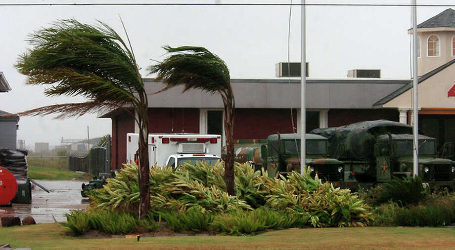Palms trees at the Sabine Pass fire station bow with the breeze Tuesday morning as Tropical Storm Edouard moves through. Tammy McKinley/The Enterprise