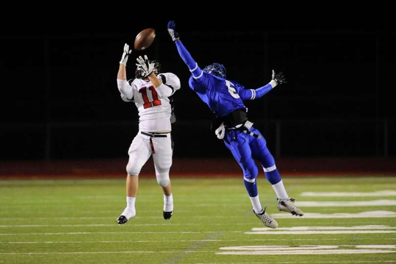 Wildcats wide receiver, Randy Musgrove, goes up for a catch for long yardage against Rice Consolidat